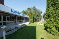 Hotel Napfeny surrounded by a green park in Balatonlelle
